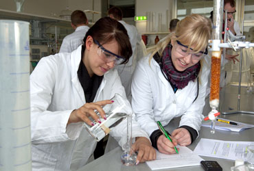 two female students in a lab
